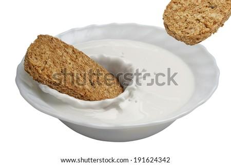 wheat biscuit in milk with splash - stock photo