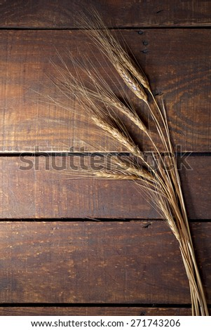 wheat ears on a vintage table in rural style