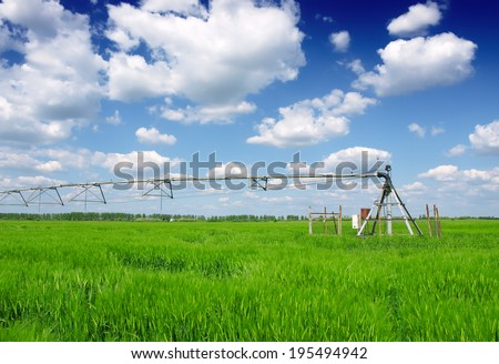 wheat field and irrigation equipment - stock photo