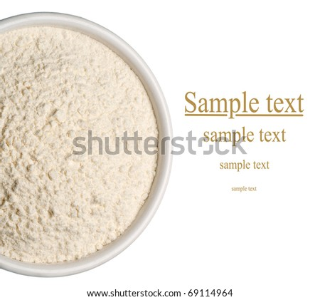 Wheat flour in a plate on white background - stock photo