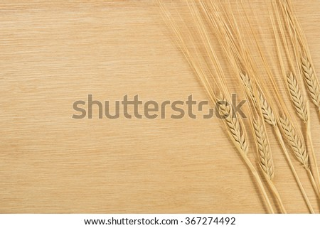 Wheat on wooden table.(recipe background)