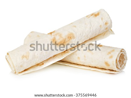 Wheat round tortillas close-up isolated on a white background. Lavash. - stock photo