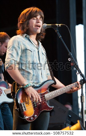 WHEATLAND, CA - JULY 26: Reid Perry of The Band Perry performs as part of Brad Paisley's Virtual Reality Tour 2012 at Sleep Train Amphitheatre on July 26, 2012 in Wheatland, California. - stock photo
