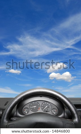 Wheel and dashboard of a car - stock photo