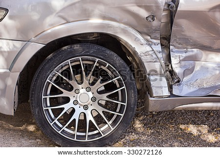 wheel and the door of the car after the accident - stock photo