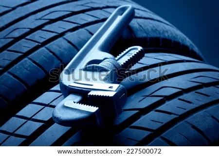 Wheel and Tools - stock photo