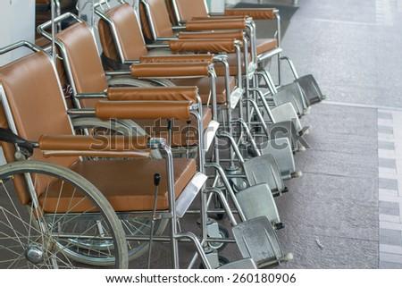 Wheel chair in the hospital corridor. - stock photo