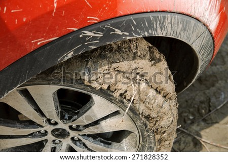 Wheel in motion with clogged tread - stock photo