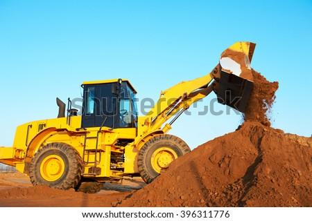 wheel loader excavator earthmoving  - stock photo