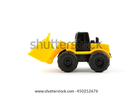 Wheel loader toy isolated on white.