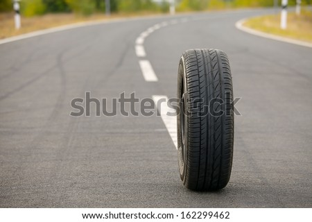 Wheel of a car on a road - stock photo