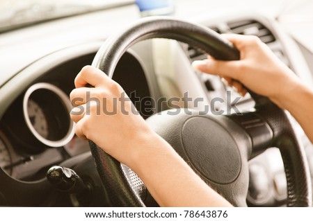 Wheel of car from hand of driver. - stock photo