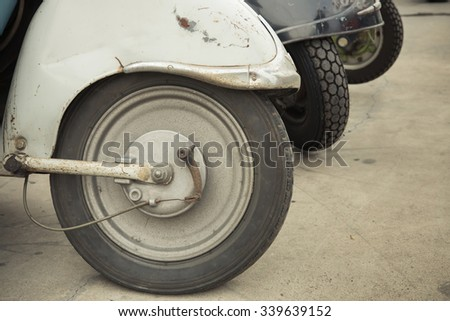 Wheel of classic motorcycle, vintage picture style - stock photo