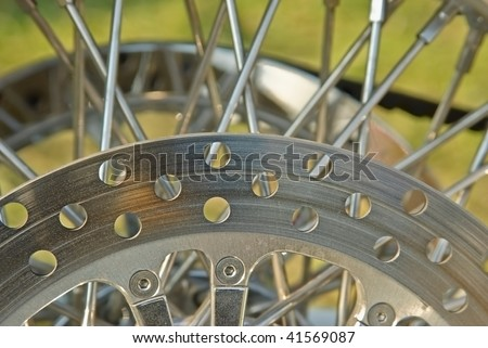 Wheel of motorcycle - disc and spokes - stock photo