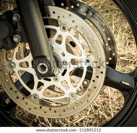 Wheel of motorcycle.  Motorbike tire on the wheel with disk abs. - stock photo