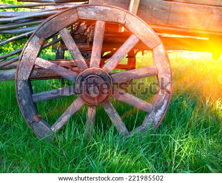 wheel of old wooden carriage - stock photo