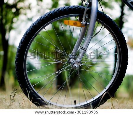 Wheel of sports mountain bike on nature background - stock photo