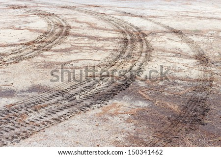 wheel of tractor on ground - stock photo