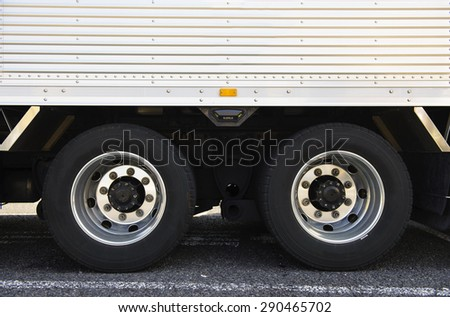 Wheel of truck and trailers - stock photo
