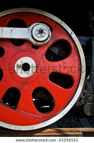 Wheel of vintage steam locomotive - stock photo
