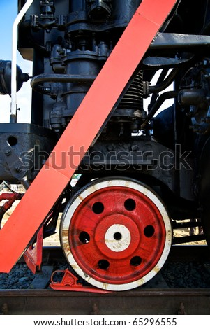 Wheel of vintage steam locomotive and drag - stock photo
