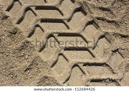 wheel track in the sand - stock photo