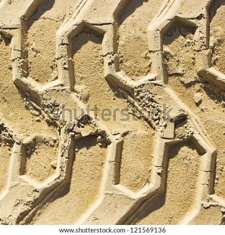 wheel tracks in the sand - stock photo