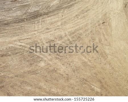 Wheel tracks on country road - stock photo
