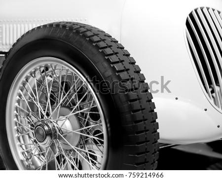 wheel with tire of racing car close up black and white color