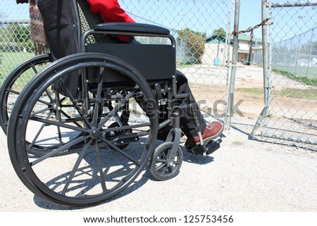 Wheelchair-bound person in front of a road block