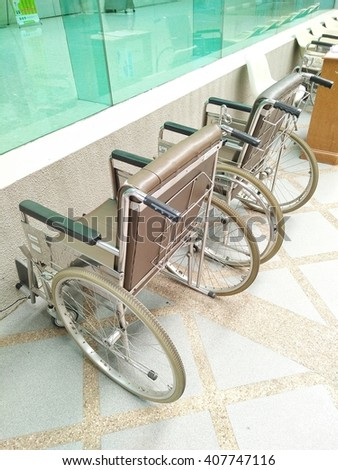 Wheelchair for patient moving standing in corridor of modern cardiology clinic hospital - stock photo