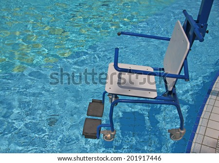 wheelchair for the disabled for use in swimming pool 2 - stock photo