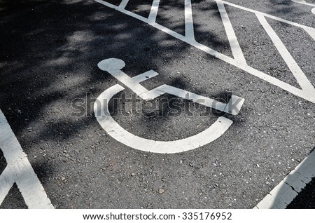 Wheelchair Handicap Sign on road street background.- Handicap parking place. - stock photo