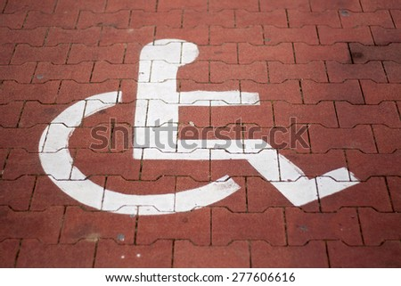 wheelchair mark on parking spot - stock photo