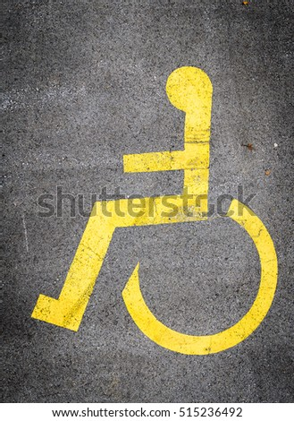Wheelchair symbol in a Parking Lot marks disabled parking space.