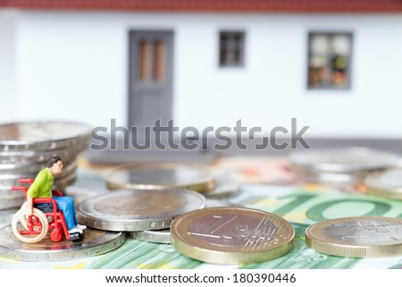 Wheelchair user in front of a house / Wheelchair user - stock photo