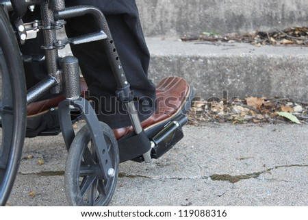 Wheelchair with barriers ahead - stock photo