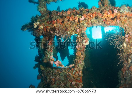 "Wheelhouse of an artificial reef named the ""United Caribbean"".  In the waters off Deerfield Beach, Florida. This wreck tilled at on its side picture taken looking straight up at the surface. - stock photo"