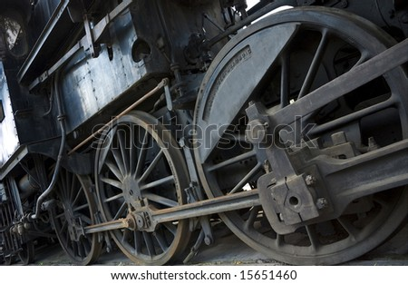 wheels of a steam engine - stock photo