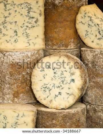 Wheels of blue cheese in a market