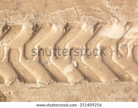 Wheels trail tread in the red mud as a background - stock photo