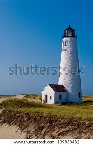 When Great Point Lighthouse was first built with no keeper's house, the early keepers had to either walk or ride horseback over soft sand, or take a boat seven miles to Brant Point get supplies. - stock photo