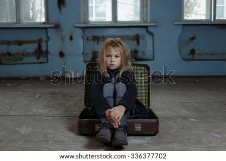Where are you. Depressed lonely little girl sitting in suitcase and feeling sad while begging for help - stock photo
