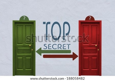 where is the top secret behind the red or the green door? A concept image showing two old doors with a top secret symbol painted on the wall in between - stock photo