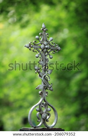 whimsical forged iron cross grave - stock photo