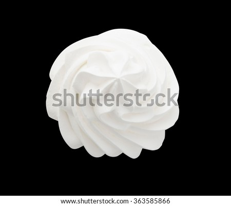 Whipped cream isolated on a black background with clipping path. Top view. - stock photo