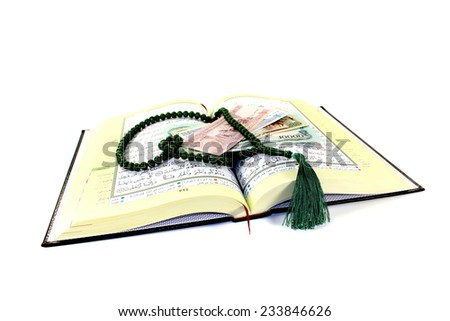 whipped Quran with Afghani before light background - stock photo