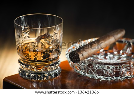 Whiskey and cigar on wooden box close up - stock photo