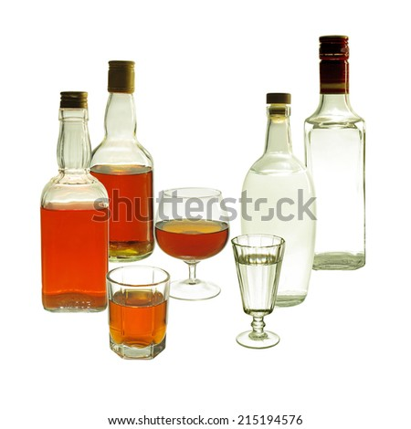 Whiskey and Gin Bottles and Glasses . Isolated on white background
