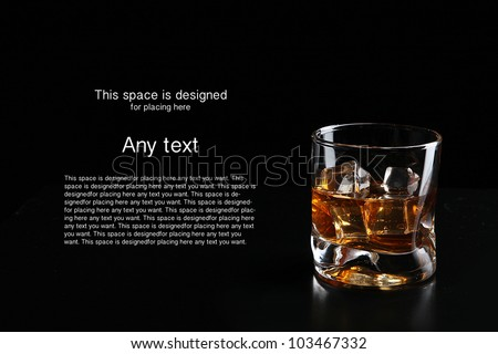 whiskey and ice cube isolated on black background - stock photo
